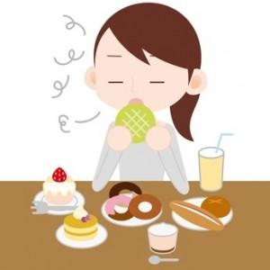 甘いものを食べる女性のイラスト
